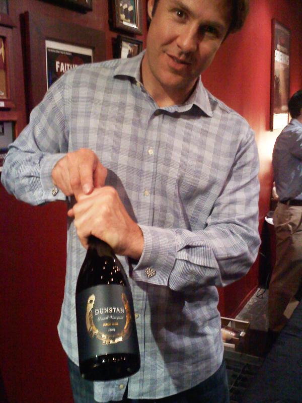 Chris Towt of Dunstan Wines uncorking another bottle