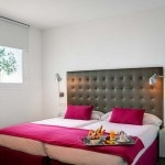 A guest room at Hotel Intur Palacio San Martin in Madrid