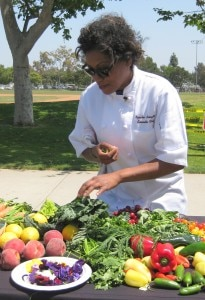 Nyesha Arrington selecting her produce