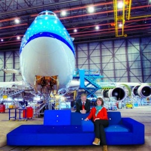 Hella Jongerius, Dutch top designer and Erik Varwijk, Managing Director KLM on the famous 'polder sofa' in the KLM-hangar, in front of a Boeing 747-400.