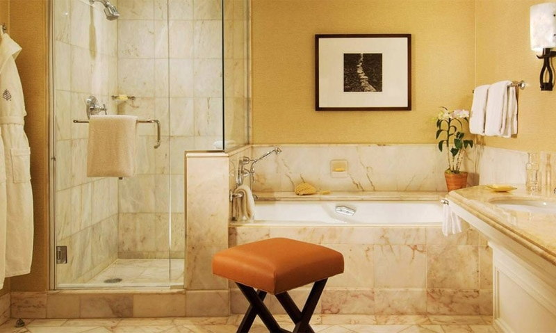 The marble bathroom of a guest room at Four Seasons Resort Maui at Wailea