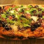 Blackberry bacon pizza