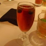 Prévu, Champagne, apricot juice, pomegranate/blueberry juice, apricot garnish