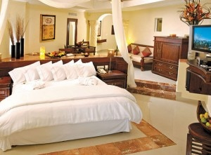 A guest room at THE ROYAL Cancun