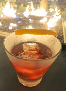 Negroni, stirred: Beefeater Gin, Campari, Caparno Antica (sweet vermouth), flamed orange peel