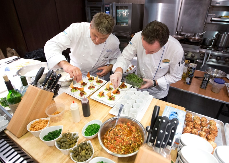 Chefs Fritz Halbedl and Marco Marrama preparing Asian-inspired spicy tuna