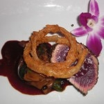 "Bigeye tuna ""au poivre"" with wild mushrooms and shishito peppers from Wolfgang Puck's American Grille"