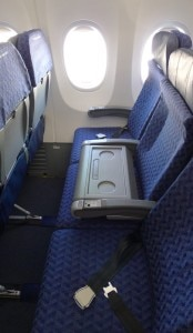 Best row in the plane with blocked middle seat
