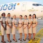 flydubai flight attendants stand near the 7000th Boeing 737 aircraft