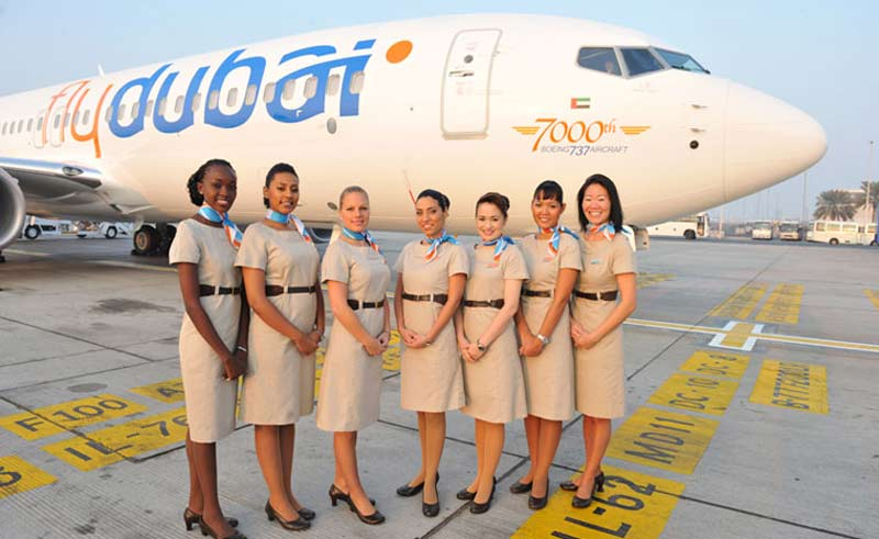 flydubai flight attendants stand near the 7000th Boeing 737 aircraft