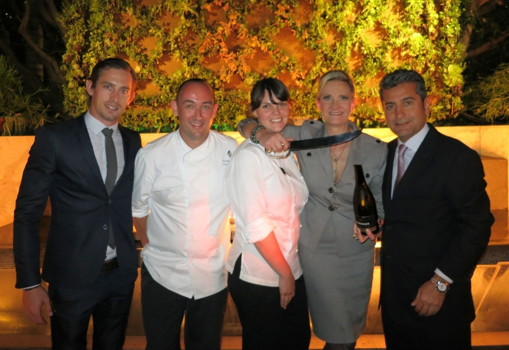 Team members of the Four Seasons Hotel Los Angeles at Beverly Hills: Culina general manager Joseph Ramaglia, hotel executive chef Ashley James, Culina executive chef Mette Williams, hotel general manager Mehdi Eftekari with Sophie Gayot