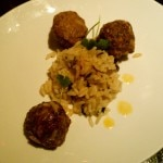 Albondigas over herbed rice