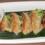 Spicy pork-and-kimchi dumplings with ginger-soy dipping sauce