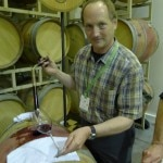 Christopher Howell of Cain Vineyards pours a barrel sample of Cain 5 at Auction Napa Valley 2013