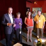Jean-Charles Boisset kicks off the barrel auction in the Red Room at Raymond Vineyards with Auction Chairs Shari andf Garen Staglin