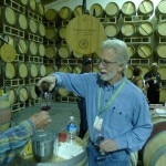 Tim Mondavi for Continuum Estate pouring a barrel sample at the Wine Auction Napa Valley 2013