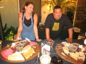 Later in the evening, where is chef Eric Greenspan? At The Cheese Store of Beverly Hills table
