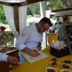 Chef Ilan Hall signing plates during Top Chef lunch