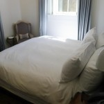 View of the bed in a guest room at Washington School House Hotel in Park City, Utah