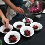 The chefs prepare the red beet and blackberry salad