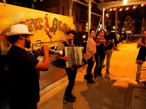 A gypsy rock band outside Rustic L.E.S.