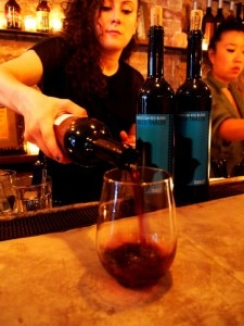 Wine being poured at the one-year anniversary celebration at Rustic L.E.S.