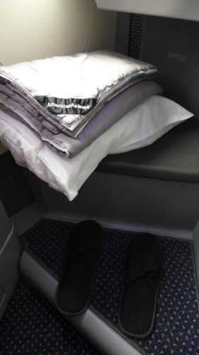 Bedding and slippers for Business Class passengers on American Airlines' new Boeing 777-300ER