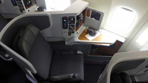 business class seat 500x281 Luxurious Perks in Business Class on American Airlines New Boeing 777 300ER   Travel News