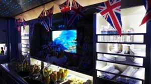 The self-service, walk-up bar on American Airlines' Boeing 777-300ER decorated for new UK route