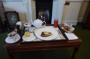 Breakfast by the fireplace at the Draycott Hotel in London
