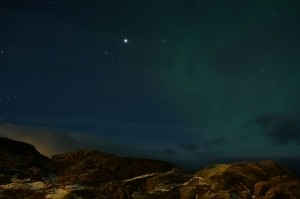 green northern light 300x199 Venus shining in the middle of a star studded green sky