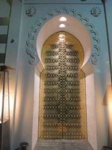 A traditional Moroccan solid brass door at the entrance