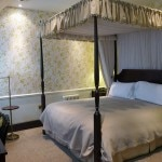 A four-posted bed room in The Mews at Ellenborough Park