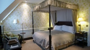 mews four poster bed 300x168 A four posted bed room in The Mews at Ellenborough Park