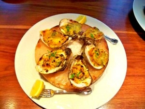 The delectable fire-roasted oysters at Restaurant R'evolution in the French Quarter (Credit: Jenny Peters)