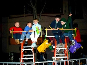 kids on ladders 300x225 Kids Watching the Parade