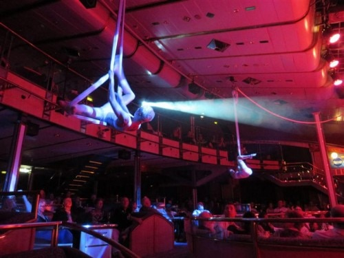Acrobats over the audience on the Cuba Cruise