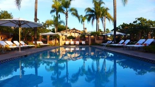 The pool at Rancho Valencia Resort & Spa at sunset