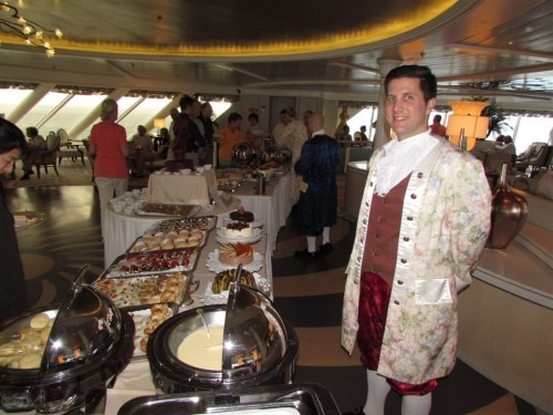 A server dressed in formal 18th-century garb during Mozart Tea
