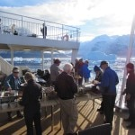 Guests enjoy a savory barbecue on the back deck of the ship