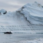 Passengers get an upclose look at massive icebergs on the Zodiac