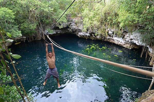Zip-lining across a cenote near Puerto Morelos