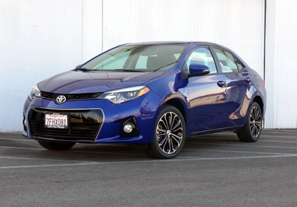 A three-quarter front view of a 2015 Toyota Corolla S Premium