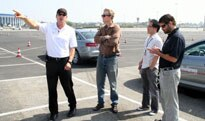 An instructor explaining the course to student drivers