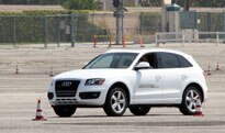 A 2009 Audi Q5 on the course