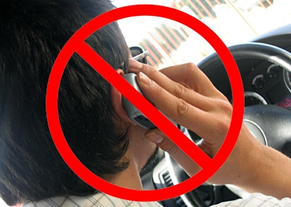 Hands-free law bans hand-held devices while operating a vehicle