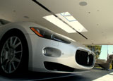 A view of the front bumper of a Maserati vehicle parked in an award-winning garage