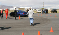 Drivers and coaches on the speed run training course at the World Class Driving Car Club