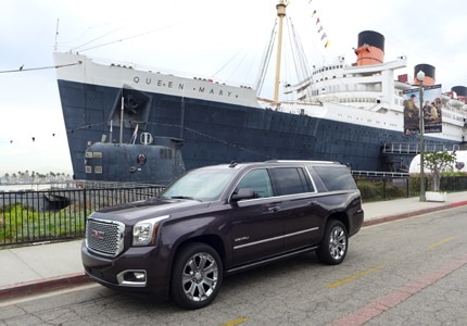 The 2016 GMC Yukon XL Denali 4WD in front of the historic Queen Mary