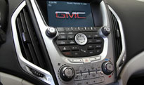 Computer and controls on the interior dash of the 2010 GMC Yukon Terrain